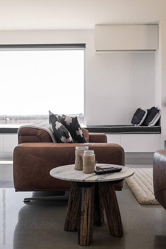 Large leather sofa in plush lounge by Rowena Naylor for Stocksy United