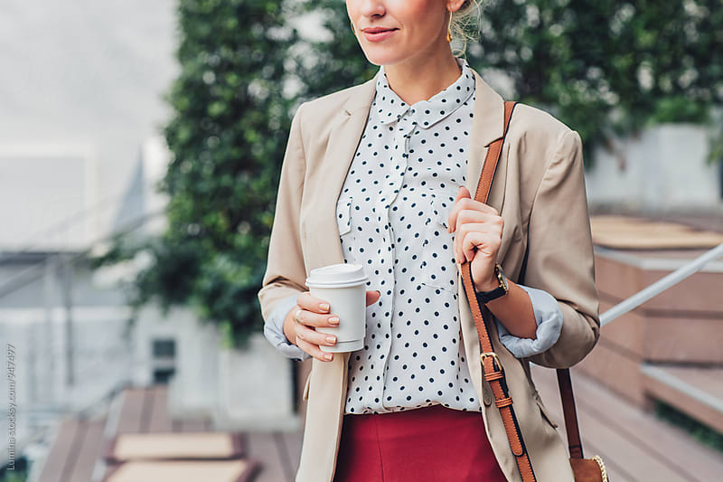 Businesswoman Drinking Coffee  by Lumina for Stocksy United