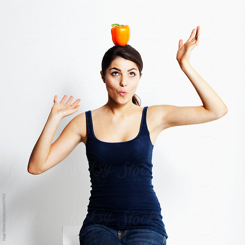 Woman having fun with various fruits by Hugh Sitton for Stocksy United