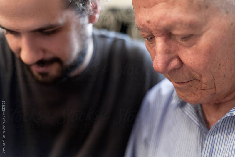 Grandfather and his adult grandson by Jovana Milanko for Stocksy United