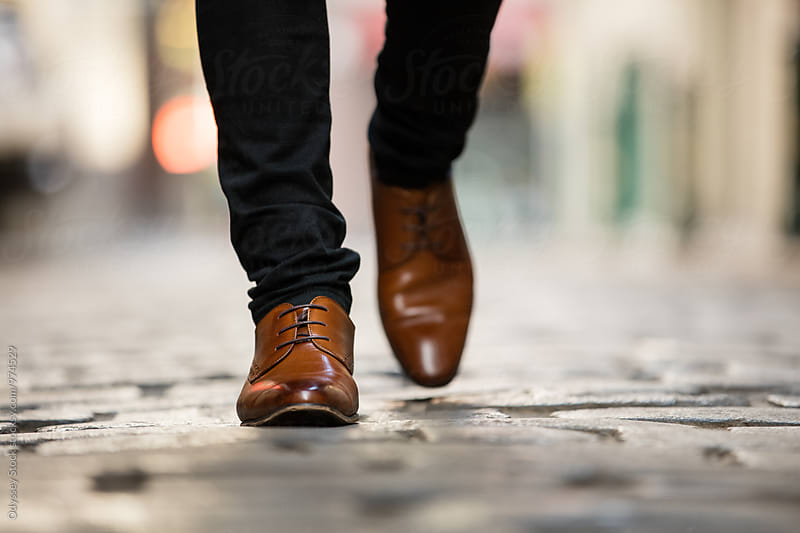 Italian Leather Shoes Walking on Cobblestone Street by Odyssey Stock for Stocksy United