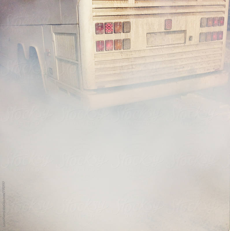 Exhaust pipe smoke of an old bus by Luca Pierro for Stocksy United