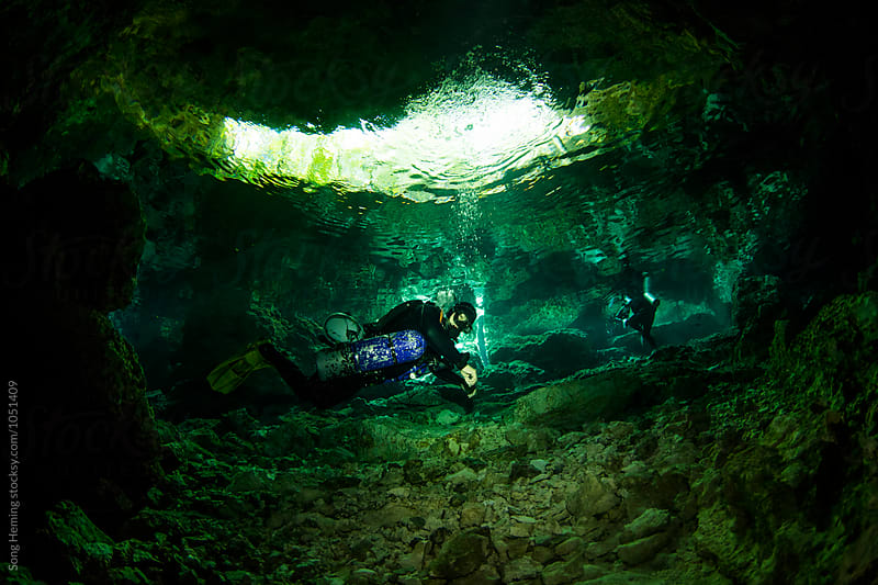 A scuba diver swimming in Mexico's Tajma ha Cenote by Song Heming for Stocksy United
