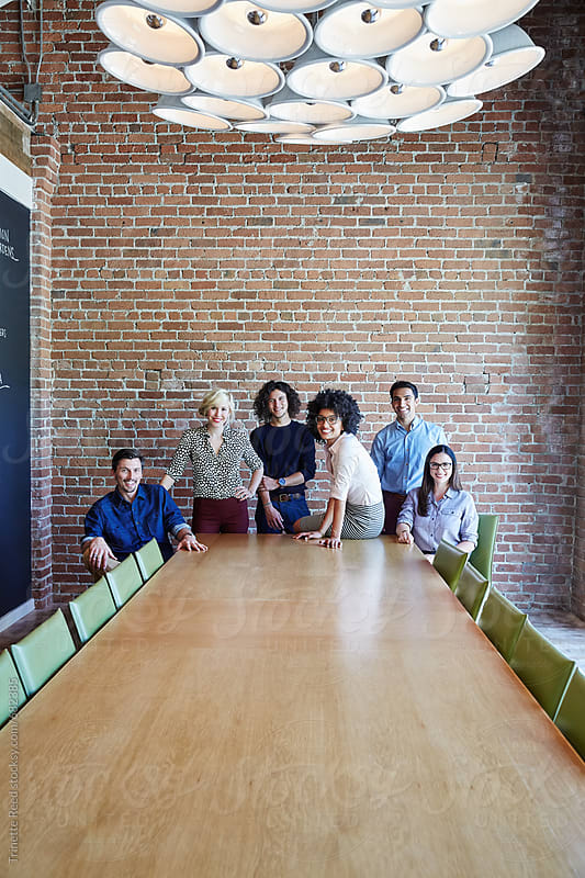 Group portrait of millennials at start up business  by Trinette Reed for Stocksy United