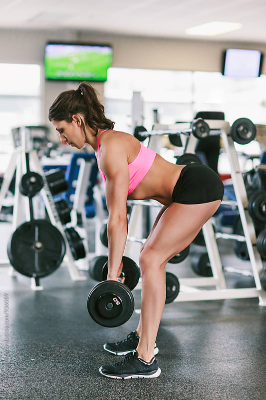 Woman working out doing deadlift in the gym  by Suprijono Suharjoto for Stocksy United