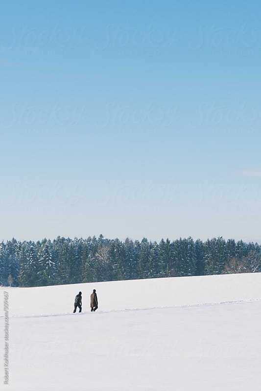 Winter landscape with two hikers in austria by Robert Kohlhuber for Stocksy United