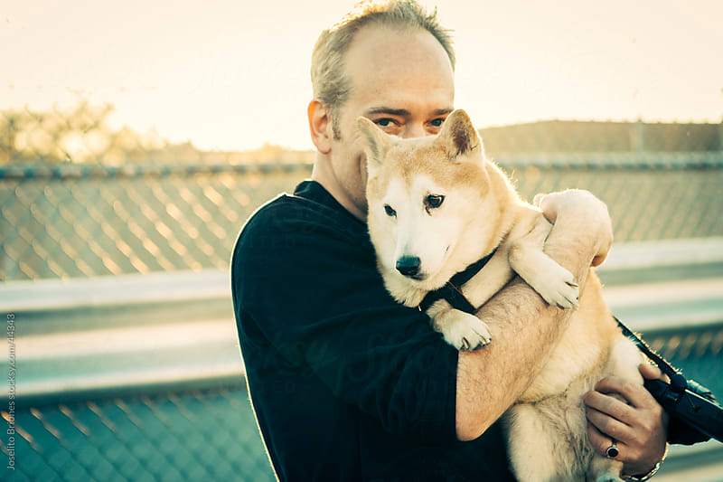 Man with Shiba Inu Pet Dog at Sunset by Joselito Briones for Stocksy United