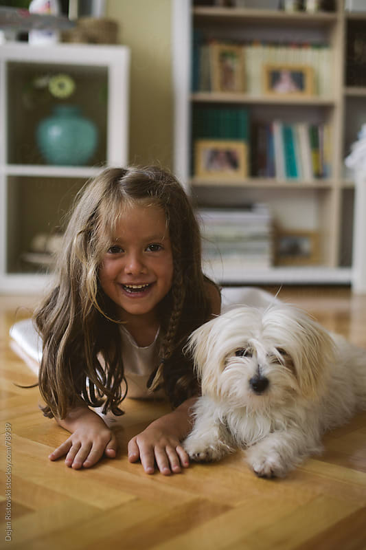 Child enjoying with her pet by Dejan Ristovski for Stocksy United