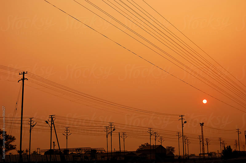 Electric power transmission lines at sunset by Saptak Ganguly for Stocksy United