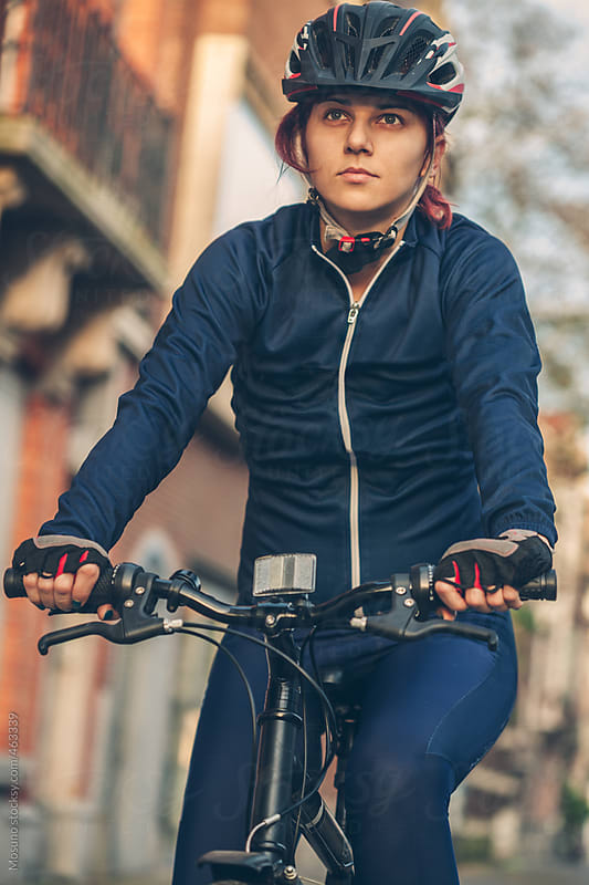 Woman Cycling  by Mosuno for Stocksy United