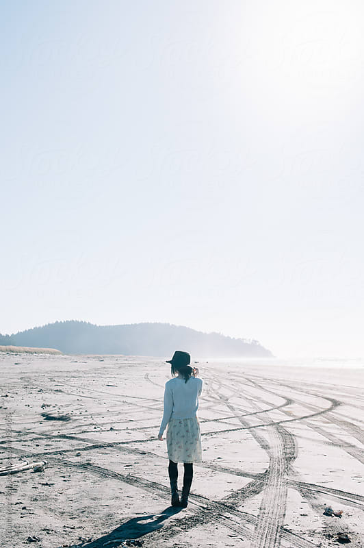 Young Woman on An Empty Beach by Briana Morrison for Stocksy United