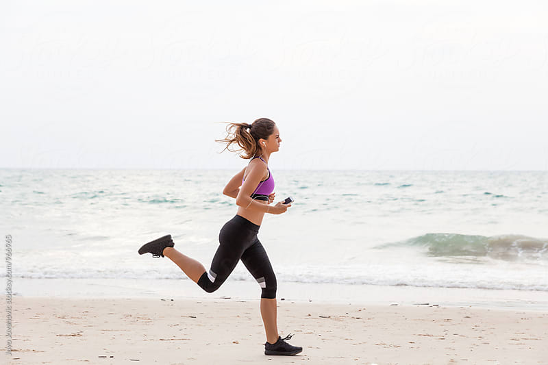 Woman running on the beach - fitness outdoors by Jovo Jovanovic for Stocksy United