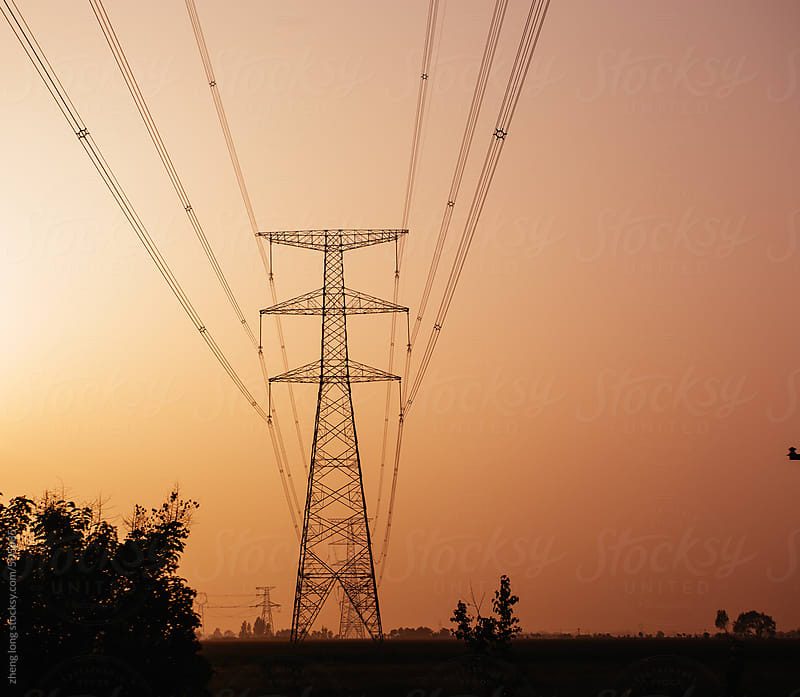 High voltage tower at sunset by zheng long for Stocksy United