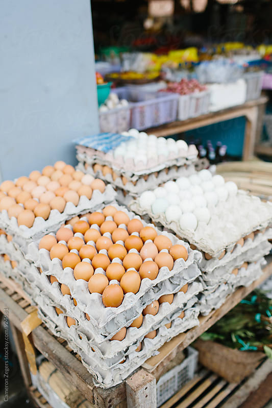 eggs at a market in Bali by Cameron Zegers for Stocksy United