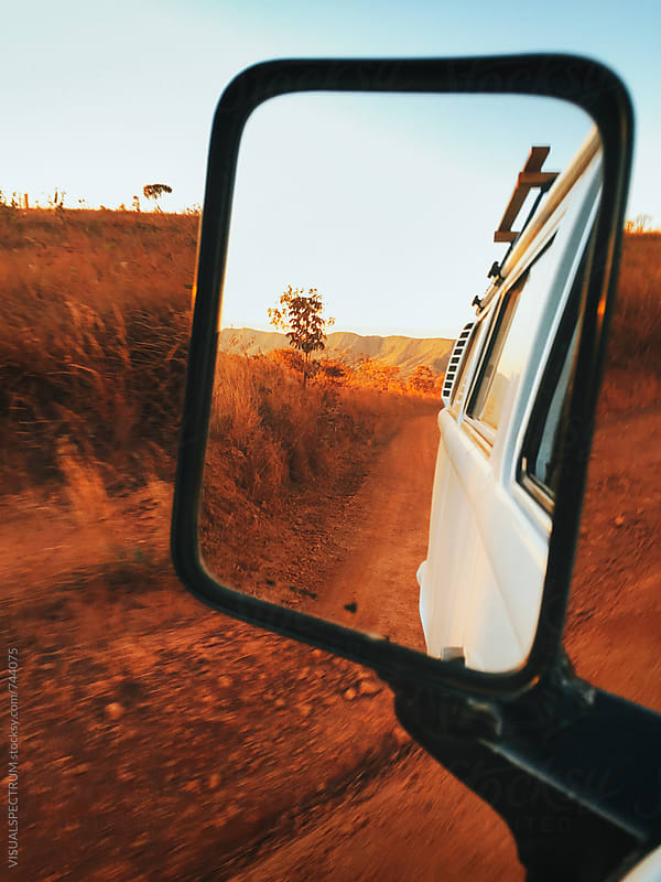 Dry Grassland at Sunset Seen Through Rear Mirror (Chapada dos Veadeiros, Brazil) by Julien L. Balmer for Stocksy United