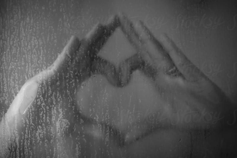 Hands making a heart in the shower by Jonas Räfling for Stocksy United