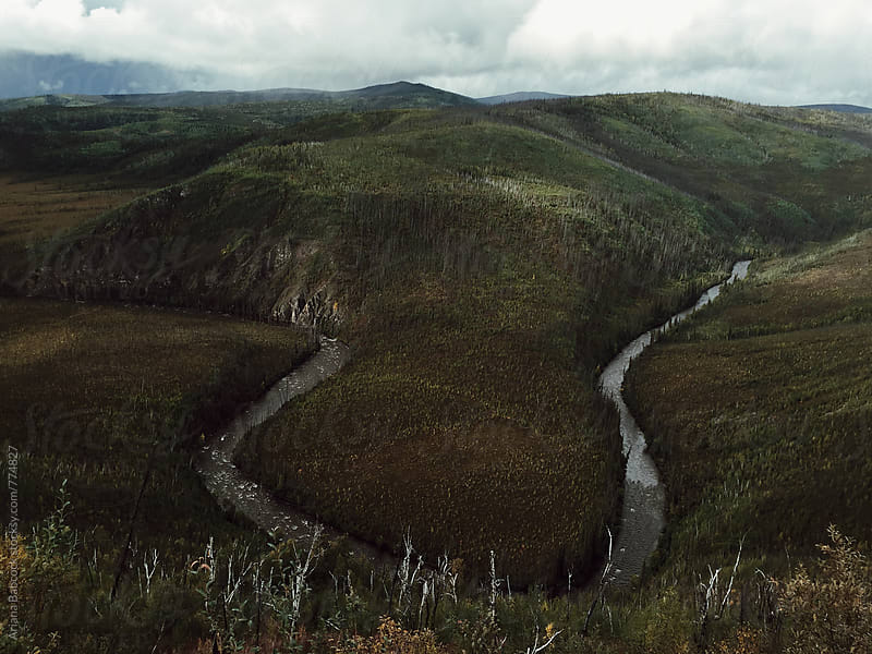 river winding through a valley by Ariana Babcock for Stocksy United