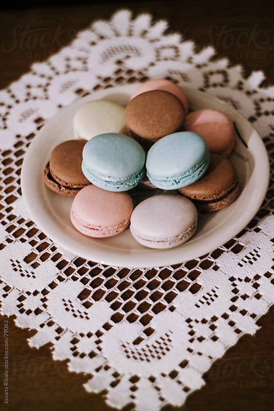 Colourful macaroons on the table. by Jovana Rikalo for Stocksy United