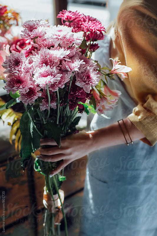Woman Holding a Flower Bouquet. by Lumina for Stocksy United