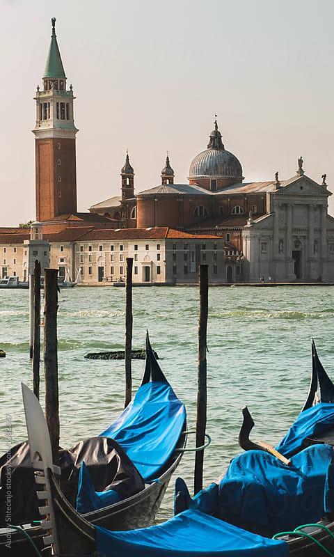 Gondola boats with San Giorgio Maggiore basilica in background/Venice by Marko Milanovic for Stocksy United