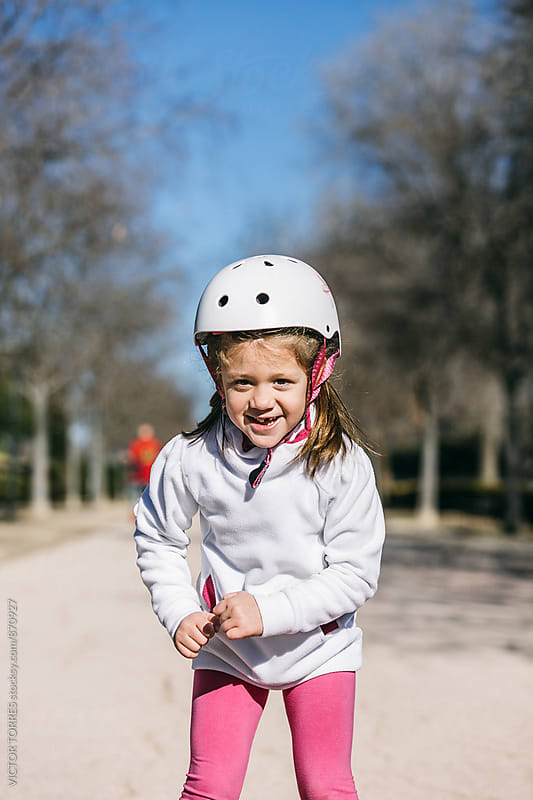 Little Girls Rollerblading in the Park by Victor Torres for Stocksy United