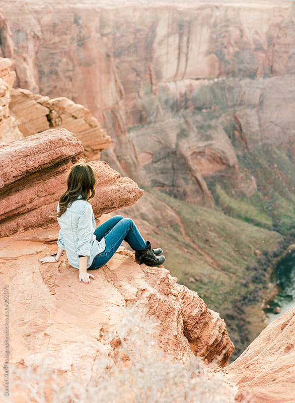 Girl overlooking canyon by Daniel Kim Photography for Stocksy United