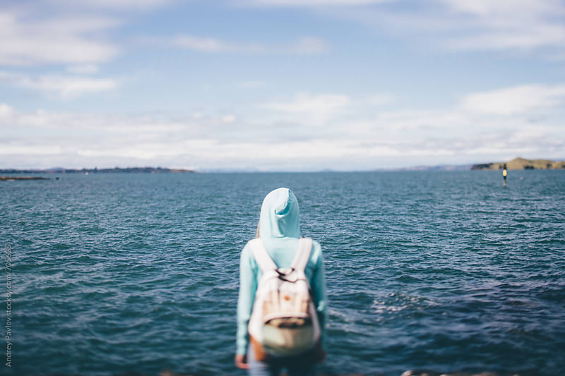 Woman looking at sea by Andrey Pavlov for Stocksy United