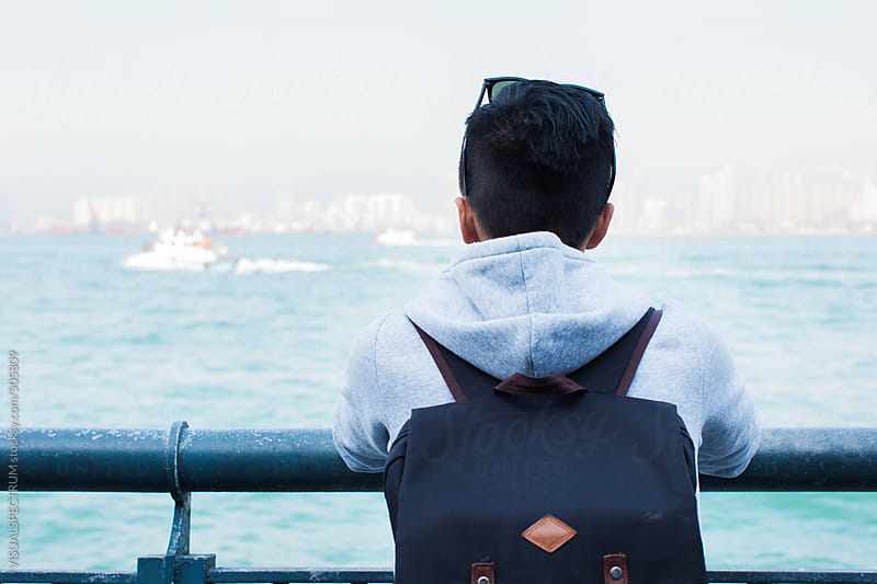 Back of Trendy Asian Teenager Standing in Hong Kong Harbour by VISUALSPECTRUM for Stocksy United