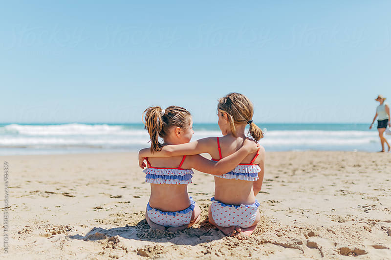 Little Sisters Having Fun at the Beach by Victor Torres for Stocksy United