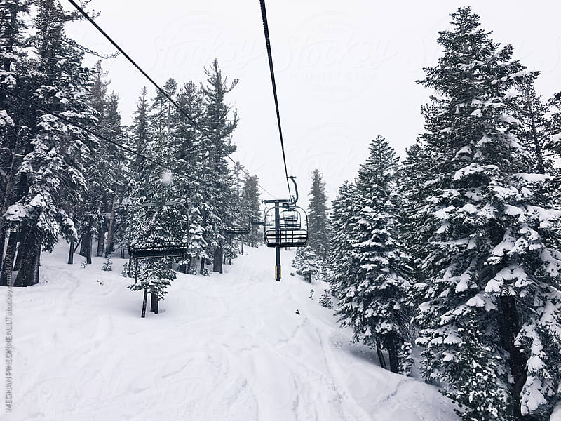 Chairlift Surrounded By Snowy Trees by MEGHAN PINSONNEAULT for Stocksy United