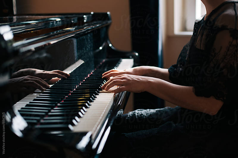 Woman playing piano indoor by VeaVea for Stocksy United