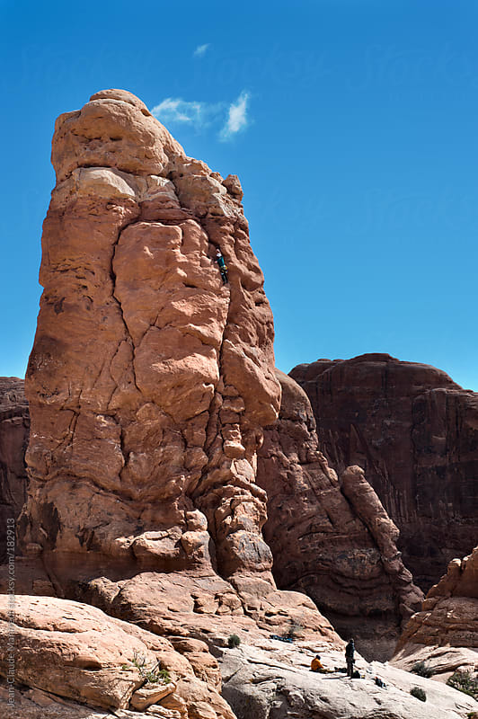 Climbing at the Arches National Park Moab Utah by Jean-Claude Manfredi for Stocksy United