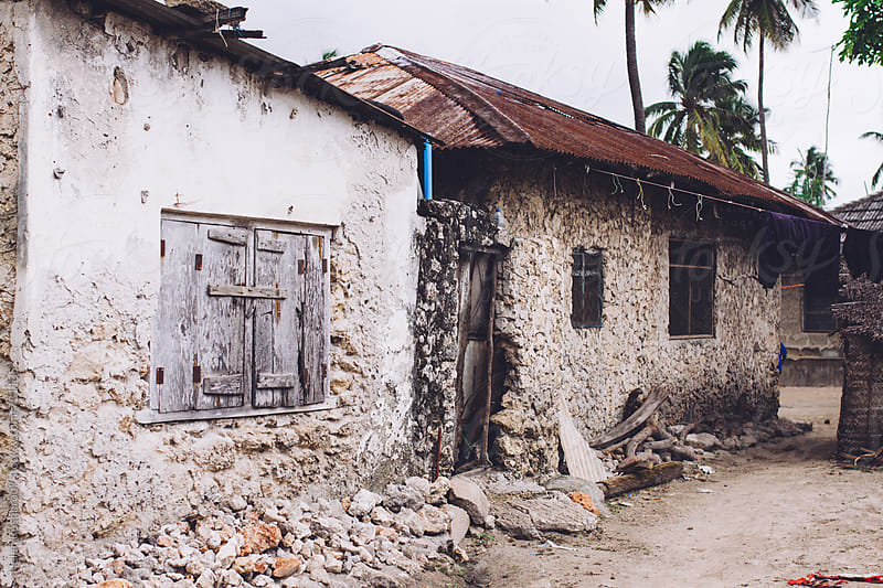 Mud and stone houses in a Zanzibar village by Helen Rushbrook for Stocksy United