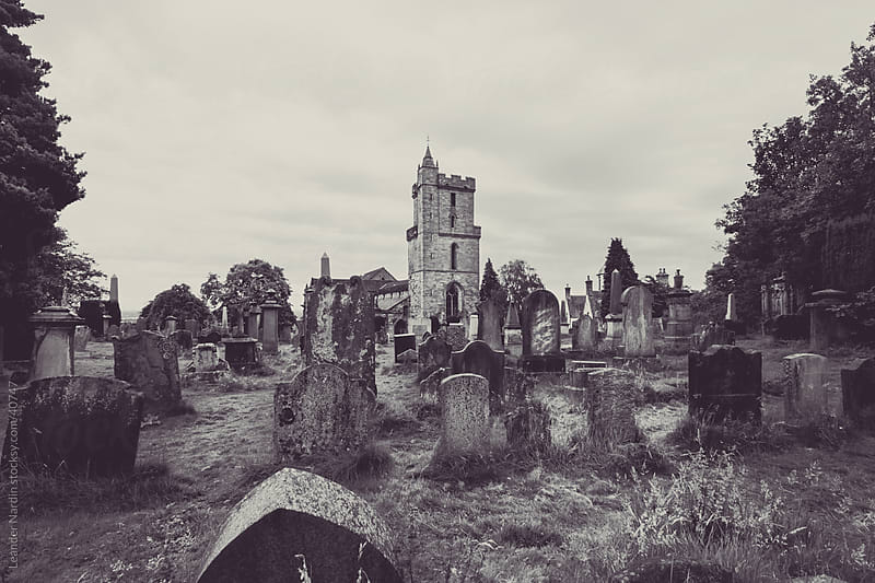 Creepy Cemetery in a mystical light by Leander Nardin for Stocksy United