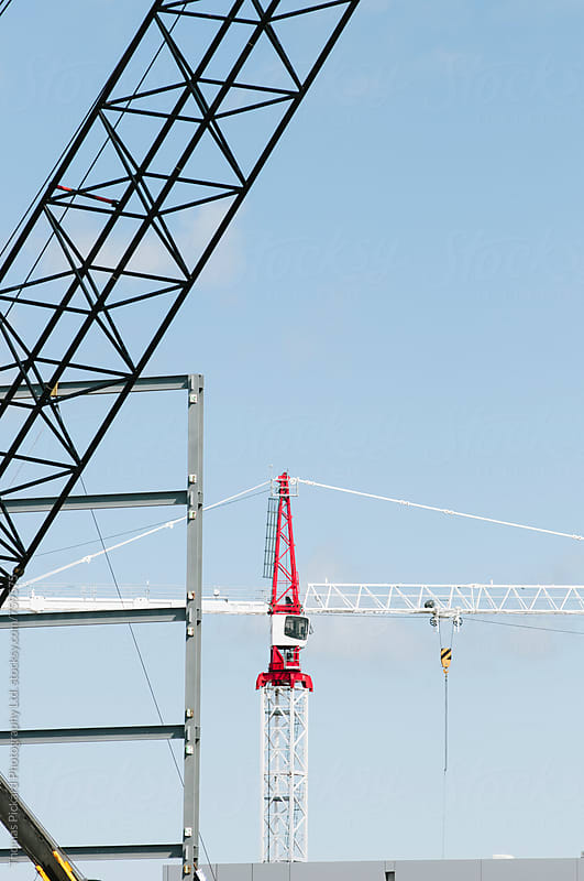 Construction cranes, Christchurch, New Zealand. by Thomas Pickard for Stocksy United