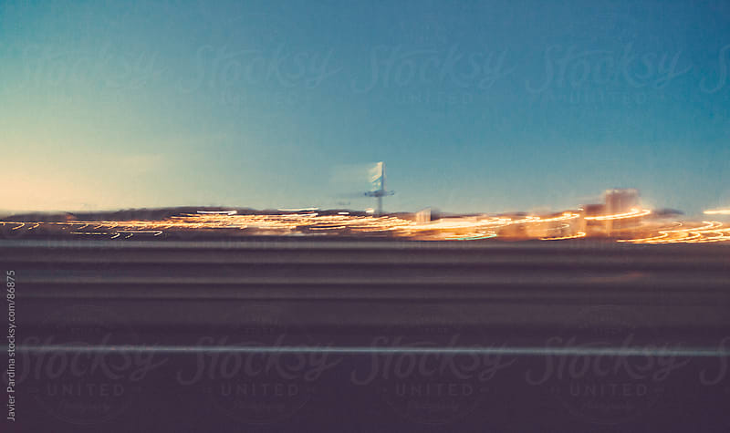 driving on the highway at sunset by Javier Pardina for Stocksy United