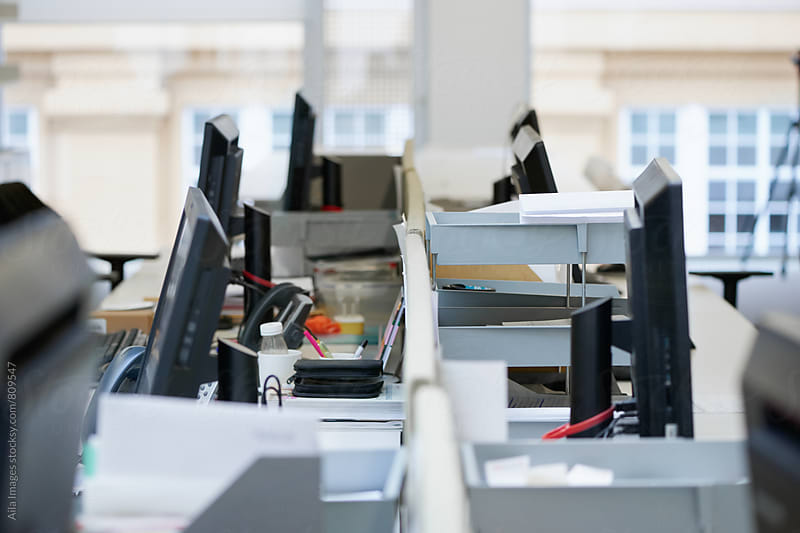Close crop of empty desks in trendy office space by Aila Images for Stocksy United