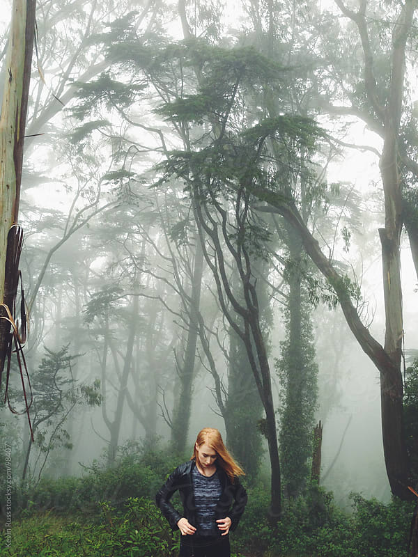 Woman in Foggy Forest by Kevin Russ for Stocksy United