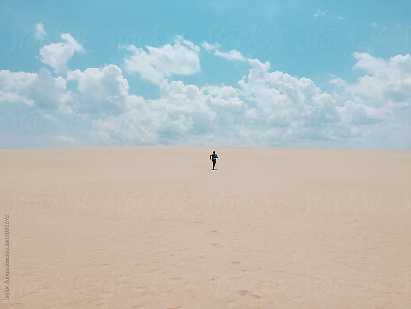 Running up a Sand Dune by Taylor Kampa for Stocksy United