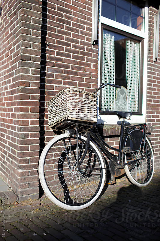 Bicycle with basket by Marcel for Stocksy United