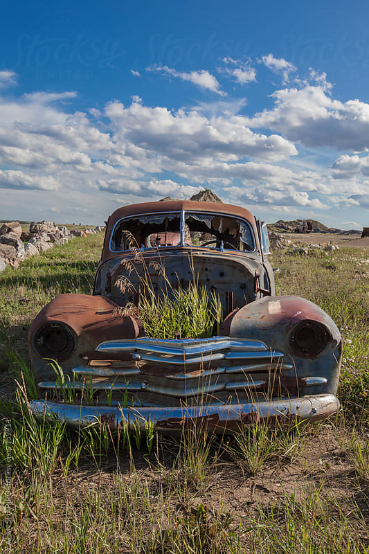 Abandoned rusty car by ALAN SHAPIRO for Stocksy United