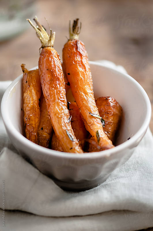 Food: roasted carrots with honey and thyme by Laura Adani for Stocksy United
