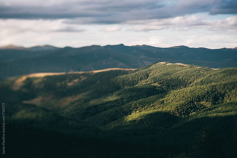part of mountains with sky by Javier Pardina for Stocksy United