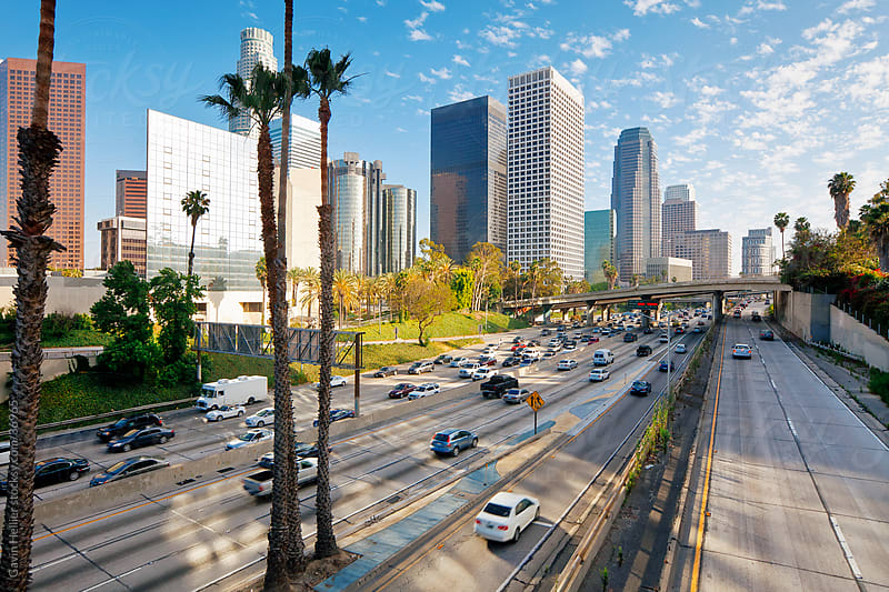 The 110 Harbour Freeway and Downtown Los Angeles skyline, California, United States of America by Gavin Hellier for Stocksy United