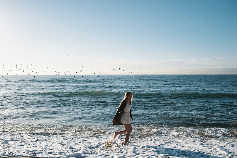 Young blonde woman running in the sea by WAVE for Stocksy United