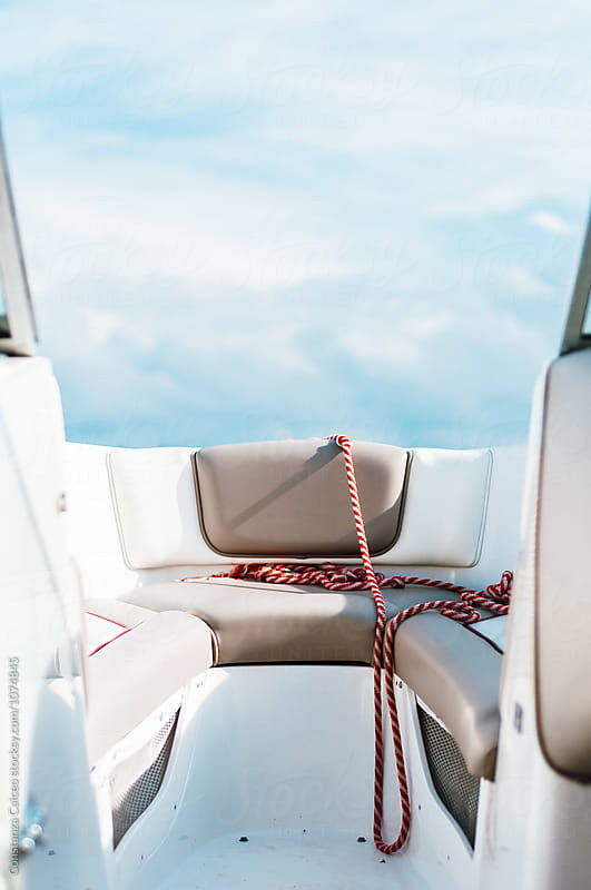 Boat seats and red rope  by Constanza Caiceo for Stocksy United