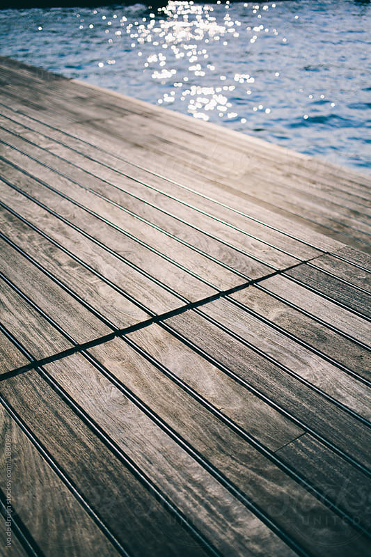 Close up of a pier with the river in the background by Ivo de Bruijn for Stocksy United