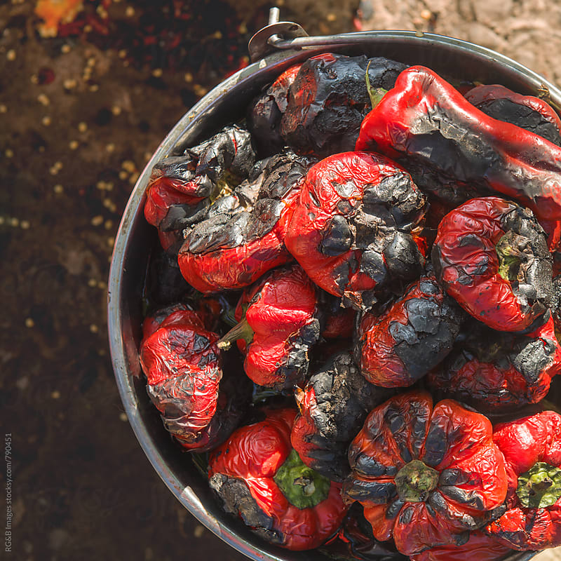 Roasted red peppers in a pot outdoor by RG&B Images for Stocksy United