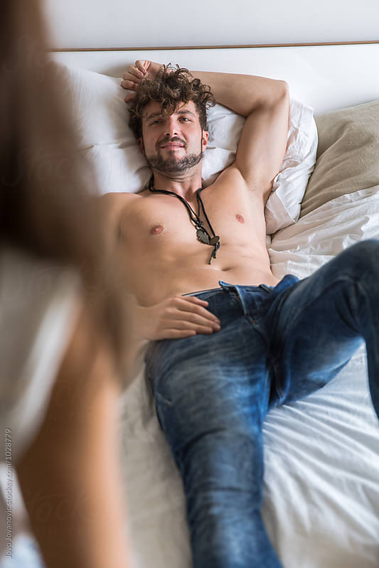 Young sexy couple in bedroom by Jovo Jovanovic for Stocksy United