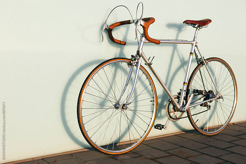 Vintage bicycle against a wall. by BONNINSTUDIO for Stocksy United